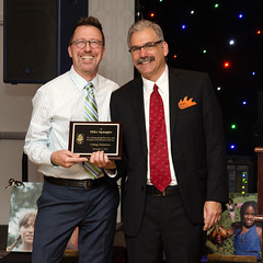 Mike Spangler (left), recipient of award for 30 years of continuous service, shown with (right) Executive Director Rob Kutzik