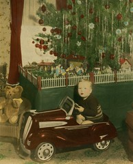 A Pedal Car for Christmas (Alan Mays) Tags: christmas xmas old trees decorations red brown green cars boys portraits vintage children toys 1930s holidays interiors rooms photos pennsylvania antique bears wheels ephemera pa photographs ornaments stuffedanimals handpainted artdeco pedals streamlined autos christmastrees handcolored nativity harrisburg tinted automobiles fenders teddybears streamline toycars handtinted foundphotos nativities crche artmoderne pedalcars nativityscenes streamlinemoderne december25 dauphincounty mangers mangerscenes vptp harrisburgareakid