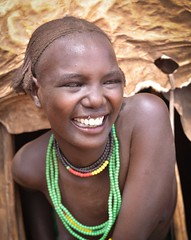 Girl, Dassanech, Ethiopia (Rod Waddington) Tags: africa portrait woman girl female outdoors beads village skin african candid traditional culture goat valle tribal hut valley afrika omovalley ethiopia tribe ethnic cultural ethnicity afrique ethiopian omo etiopia ethiopie etiopian omorate dassanech