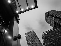 london-7-141215 (Snowpetrel Photography) Tags: winter sky blackandwhite london monochrome skyscrapers streetphotography cityscapes canarywharf modernarchitecture urbanlandscapes olympusm1240mmf28 olympusem5markii