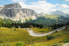 Sella Pass (Vee living life to the full) Tags: italy leger travel touring holiday landscape rock pass pordoi sella towers sasspordoi mountain people nikond300 heathaze valley floor motorcycle view car park road sky cloud blue