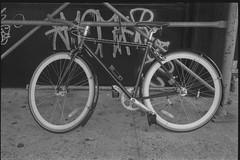 secured bike (je245) Tags: leicam3 leicasummicron50mmf20rigid kodak tx400 diafine nyc newyork