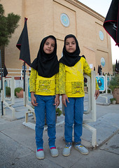 Portrait of iranian shiite twin girls in the rose garden of martyrs cemetery, Isfahan province, Isfahan, Iran (Eric Lafforgue) Tags: 2people 89years ashura cemetery children colorimage commemoration dead death esfahan flag fullframe fulllength girlsonly glorify grave grief iran iranianculture isfahan islam ispahan lookingatcamera martyrs memorial memories memory middleeast mourning muharram outdoors persia photography placeofburial sadness shia shiite tomb tombstone tradition tranquility tribute twin twopeople vertical war isfahanprovince ir