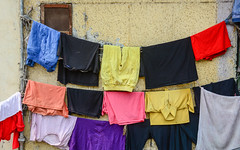 Clothing dried in the sun (phuong.sg@gmail.com) Tags: asia attraction banking bathing benares burial city clothes color dry fire ganges ghat hindu hinduism historic holy household india landmark laundry life lifestyle outside pants pilgrimage pradesh quay religion river rope sacred shiva shore skirt street sun tourist town tradition traditional travel varanasi vivid washing water white