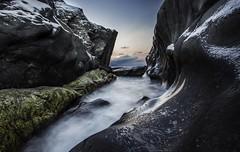 Water beats rock. (Rolland - Tomas) Tags: seascape landscapes sea ocean rocks stones coast naturephotography nature troms norway
