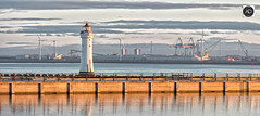All rise (alun.disley@ntlworld.com) Tags: newbrighton newbrightonlighthouse marinelakenewbrighton seaforthcontainerterminaldocks windfarm industriallandscape rivermersey water cranes windturbines sunrise clouds reflections panorama merseyside england uk liverpool portsandharbours weather