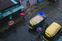 An Ordinary Rainy Day! (Ajwad Mohimin) Tags: umbrealla transport travel bangladesh bangladeshi garmentsworker worker workers color colorful life lifestyle lifescape red blue yellow chittagong canon canon60d 18 18mm street