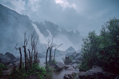 Athirapally Waterfalls (Color version) (Vilvesh) Tags: athirapally athirapallywaterfall bw monochrome waterfalls nature monsoon weather kerala thrissur godsowncountry rain nikond750 nikon24120 landscape travel outdoor sky serene cloud mountain colors