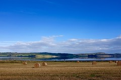 Beauly Firth, near Inverness (timnutt) Tags: scotland highlands sky blue water highland autumn firth beauly inverness field hay bales bale reflection clouds