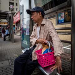 one man and his dog (Rob-Shanghai) Tags: dog shanghai busstop china street man basket waiting leica leicaq