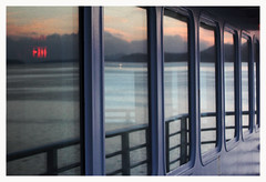 Inside Out (R. Drozda) Tags: britishcolumbia canada insidepassage archpelago mvkennicott alaskamarinehighway alaskaferry reflection window exitsign water pacificocean mountain sky sunset drozda