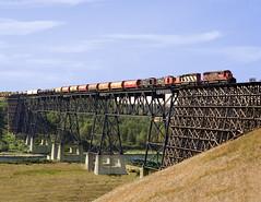 Heatburg AB Tuesday September 11th 1990 1248 MDT (Hoopy2342) Tags: train rail railway railroad alberta ab alta ardley reddeerriver canadiannational canadiannationalrailways bridge prairie