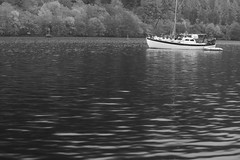 Boat, Loch Oich (Henry Hemming) Tags: water bw ripple distance stillness frame composition loch scotland lake surface still smooth yacht boating