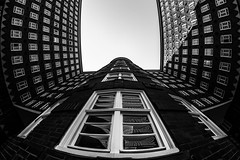 Big flapping bird of brick and glass / Someday i'll fly away (zgr Grgey) Tags: 12mm 2016 bw d750 hamburg nikon samyang sprinkenhof unesco worldheritagesites architecture bricks fisheye glass windows