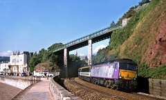 This loco was under trial with First prior to their order for replacent sleeper motive power....however Purple Ronnie proved reluctant to leave the cosy confines of Laira on numerous days...so lucky ere!....1A43 57601 09-30 Plymouth-Paddington Teignmouth (the.chair) Tags: 1a43 57601 0930 plymouthpaddington teignmouth aug 2001