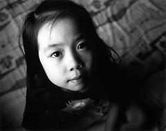 Nunu () Tags: opdanphotonote hasselblad503cw 60mmcft 400tx ilfordmgfbclassicglossypaper durstm805bw rodenstockaporodagonn80mmf4 nunu child portrait bw darkroomenlargedprint negativefilm