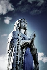 Maria (tiki.thing) Tags: blue sky statue clouds outdoors beads mary holy age rosary weathering