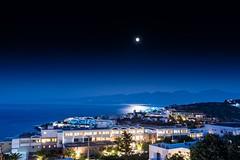 Moonlight, Schisma, Crete (jack cousin) Tags: light sea moon seascape building tree lights nikon hill crete moonlight nightsky nightscene shimmer reflction electriclights d610 distantlights roomlights buildinglights on1photos moonrelectiononthesea