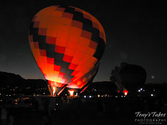 Balloons light up the pre-dawn sky