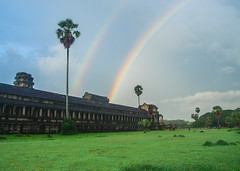Double Rainbow (D Song) Tags: travel blue sky playing heritage wet water rain silhouette architecture clouds sunrise children temple se boat jump rainbow ruins asia cambodia village olympus unesco ankor dslr wat flooded