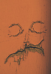 the orange man (L. Paul) Tags: wood orange abstract face mouth eyes paint mountpleasant iowa paintchip paintchipping henrycounty
