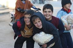 Children in Ariha, Idlib, receive free bread (Ummah Welfare Trust) Tags: poverty children war islam aid hunger arab syria humanitarian إدلب، سوريا