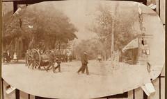 Firemen Pulling Early Hose Cart
