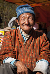 Thimphu Vegetable Market (whitworth images) Tags: asian portrait market asia robe old himalaya person himalayas gho bhutan orange woven beanie vendor man male produce traditional travel goods thimphu vend outdoors trade people sell weekend bhutanese thimphudzongkhag