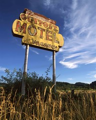 If Not For The Sign (RZ68) Tags: outpost motel laytonville california countryside old vintage big yellow sunlight grass raking clouds high 101 gone broken neon sign motor lodge rz67 velvia provia e100 poles vacancy blue