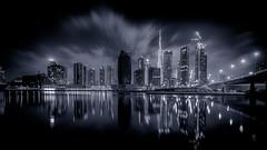 Monochromatic Urban (wissow) Tags: 500px architecture burjkhalifa businessbay cityscape clouds facebook mydubai night published socialmedia