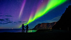 watching aurora (pixelthon) Tags: aurora borealis iceland travel nature spectacle northern lights nordlichter blue night nightshot stars colorful sea mountains green purple island reise exposure longtime canon lightroom panorama placetobe world wow