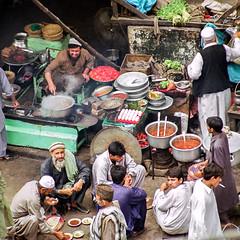 Local restaurant in Peshawar, Pakistan (travelingmipo) Tags: travel photo film pakistan     pakistani peshawar     silkroad  street people bazaar market   restaurant
