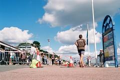 Runners, Poole Beach (Chi Bellami) Tags: film fujifilm fujicolor c200 nikon nikonosv 35mm zonefocus scalefocus scanned scan colour c41 negative photohippo chibellami amphibiouscamera nikonos runners poole beach coast shore