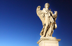 Angel with the thorn crown (Idreamofpies) Tags: bernini beauty ponte santangelo twilight rome italy photography amiamoroma sculpture sunset roma idreamofpiesphotography stone bridge angel thorn crown baroque gian lorenzo architect city planner statue river tiber