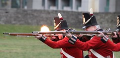 Ignition (jmaxtours) Tags: 10rvb 10throyalveteranbattalion 10thrvb rvb historicfortyork fortyork fort toronto redcoats red ignition brownbess musket fire firing shako