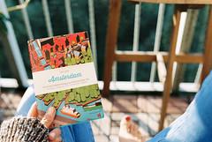 Amsterdam guide (Misiska) Tags: shadow red sun film analog 35mm book nikon kodak balcony 14 reads sigma f100 nikonf100 tip guide portra readthis shotonfilm whatiread portra400 kodakportra400 pohoda shootfilm filmisnotdead nabalkone filmshooters dailyreads