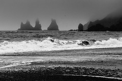 The beach at Vk (trochford) Tags: sea blackandwhite bw mist beach monochrome fog mono blacksand coast blackwhite iceland surf shoreline wave stack vik shore coastline column breaker basalt vk reynisdrangar geoiceland