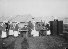 Nursing Sisters at a Canadian hospital voting in the Canadian federal election, France, December 1917 / Des infirmires militaires dun hpital canadien en France votent aux lections fdrales canadiennes, en dcembre 1917 (BiblioArchives / LibraryArchives) Tags: woman canada france hospital women election femme lac vote voter femmes bac lections hpital suffrage libraryandarchivescanada departmentofnationaldefence bibliothqueetarchivescanada december1917 nursingsisters infirmiresmilitaires ministredeladfensenationale droitdevotedesfemmes williamriderrider dcembre1917