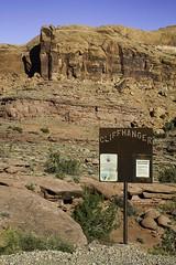 Cliffhanger (W9JIM) Tags: sign moab 40mm w9jim cliffhanger 1740l amasaback