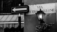 One Way (Pino Snorr) Tags: street bw italy signs lamp photography streetlight spirit streetphotography verona oneway veneto blackwhitephotos spiritofphotography twittertuesday lumixg7 viadietropallone