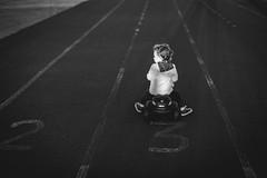 Carril 3. (Pablin79) Tags: portrait boy people street light car road white child monochrome black play dark kid funny little lines childhood one lane action argentina vicente recreation misiones vini posadas