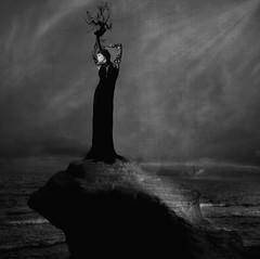 On Fire ('_ellen_') Tags: woman rock sea smoke black white dress spotlight dark light clouds sky