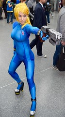 DSC_0517 (Randsom) Tags: nycc 2016 newyorkcomiccon nycomiccon javitscenter october nyc newyorkcity cosplay costume fun comicbooks comicconvention heroine superheroine blue catsuit blonde wig gun pretty sexy cute woman girl gorgeous beauty lovely highheels pumps female