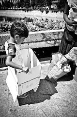 _DSC4990 (stimpsonjake) Tags: nikoncoolpixa 185mm streetphotography bucharest romania city candid blackandwhite bw monochrome boy chlid kid box playing
