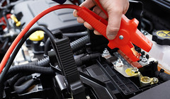 Close-up Of Mechanic Attaching Jumper Cables To Car Battery (GTD Diesels Dundalk, Co. Louth) Tags: attaching auto battery black breakdown cables car caucasian checking clamp clamping close coverall dead dirty electricity engine examining fixing flat garage hand holding horizontal human jump jumper leads maintenance male man mechanic men mending occupation one overall people person red repair service shop start transportation vehicle working