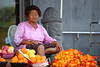 Deep marks of habitual dissatisfaction (Elios.k) Tags: horizontal outdoors jusangjeolli people oneperson woman old selling fruit stall tangerine gamgyul hallabong sweet statue travel travelling colour color summer august 2016 canon 5dmkii camera photography jungmun jeju jejudo island korea southkorea asia