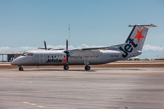 Jetstar DHC8 just out of paint shop at Townsville (Martyn Cartledge / www.aspphotography.net) Tags: aero aeroplane air aircraft airfield airline airliner airplane airport australia australian aviation civil dhc8 flight fly flying jet jetstar plane townsville transport tsv vhtqm wings wwwaspphotographynet asp photography martyn cartledge aspphotography pacific flywinglets
