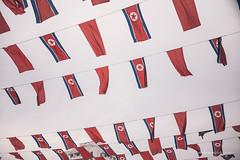 North Korea Flags (reubenteo) Tags: city red tourism war asia fireworks military korea parade communism celebration kimjongil vip metropolis comrade socialism tanks workersparty northkorea pyongyang 70thanniversary dprk kimilsung kimjongun