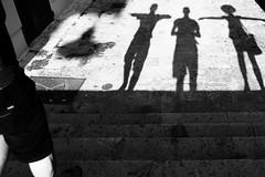Ventilation (Elios.k) Tags: street camera travel summer people blackandwhite bw italy woman sun sunlight man hot travelling tourism monochrome horizontal stairs canon walking outdoors photography foot three hands shadows wind body walk leg august tourist flipflop sweaty part only extended narrow salento puglia lecce pedestrain apulia 2015 santacesareaterme 5dmkii