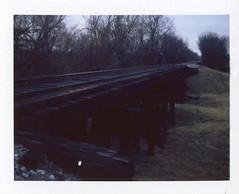 Nancy (HaydenKlein) Tags: camera blue cold film girl beautiful train walking polaroid weird scary fuji tracks eerie land instant peel fp 320 apart 100c